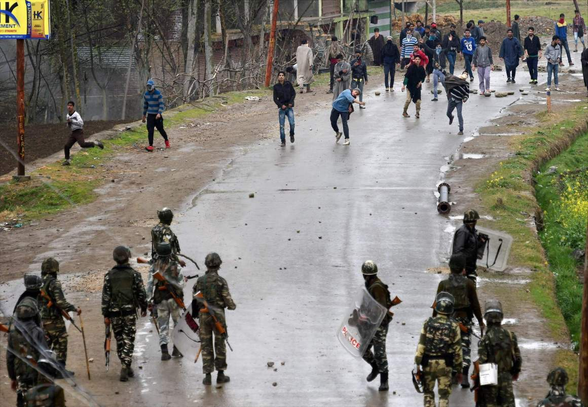 A group of youth pelting stones on security forces during an anti-militant operation at village Durbugh in Chadoora area of central Kashmir's Budgam district on Tuesday. One militant and three civilians were killed in the operation. Credit: PTI/S. Irfan