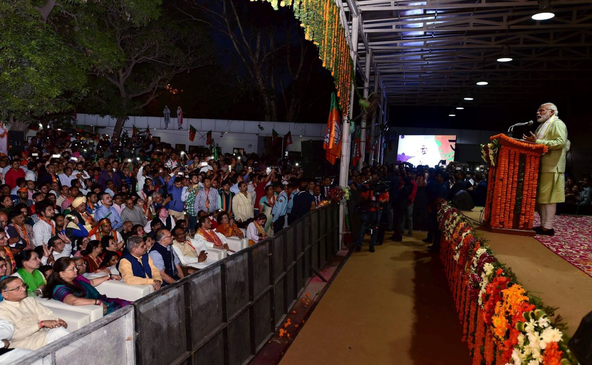Prime Minister Narendra Modi addresses supporters at the BJP's headquarters as he arrives to its celebrate victory in the UP and other Assembly elections in New Delhi on Sunday. Credit: PTI/ Manvender Vashist