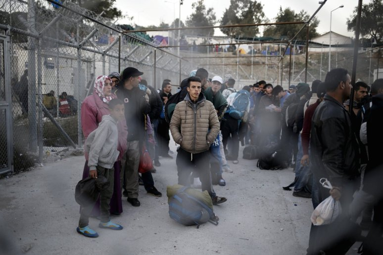 Refugees and migrants wait to be registered at the Moria refugee camp on the Greek island of Lesbos, November 5, 2015.Credit: Reuters/Alkis Konstantinidis/File Photo
