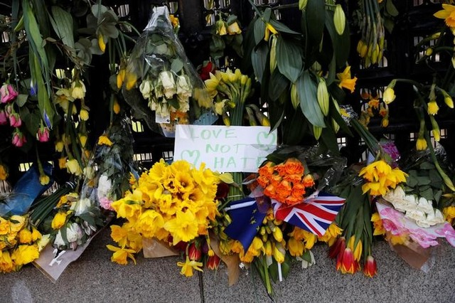 Floral tributes lie in parliament square following the attack in Westminster, central London, UK March 27, 2017. Credit: Reuters