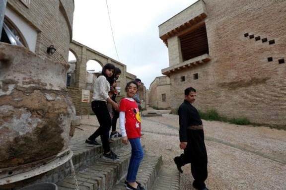 A Kurdish family tours inside Erbil Citadel, Iraq April 14, 2017. Credit: Reuters/Jamal Saidi/Files
