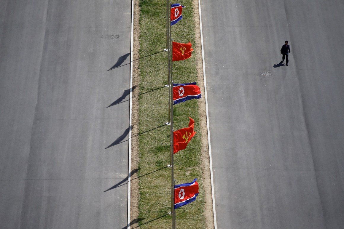 A man walks the the street decorated with flags as North Korea prepares to mark Saturday's 105th anniversary of the birth of Kim Il-sung. Credit: REUTERS/Damir Sagolj