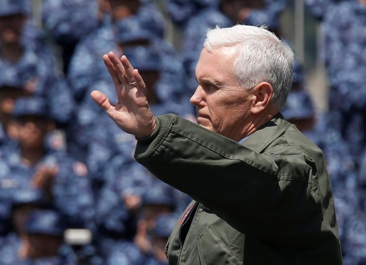 US vice president Mike Pence waves to US and Japanese service members on the flight deck of the USS Ronald Reagan, a Nimitz-class nuclear-powered super carrier, at the US naval base in Yokosuka, south of Tokyo, Japan April 19, 2017. Credit: Reuters/Kim Kyung-Hoon
