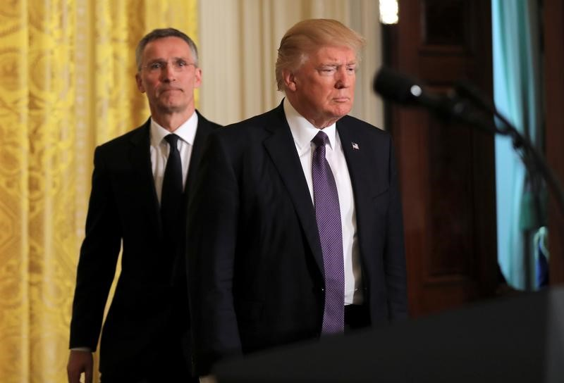US President Donald Trump (R) and NATO Secretary General Jens Stoltenberg arrive for a joint news conference in the East Room at the White House in Washington, US, April 12, 2017. Credit: REUTERS/Carlos Barria