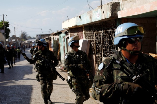 UN peacekeepers patrol the neighbourhood of Cite Soleil together with Haitian national police officers and members of UNPOL (UN Police) in Port-au-Prince, Haiti, March 3, 2017. Picture taken March 3, 2017. Credit: ReutersAndres Martinez Casares