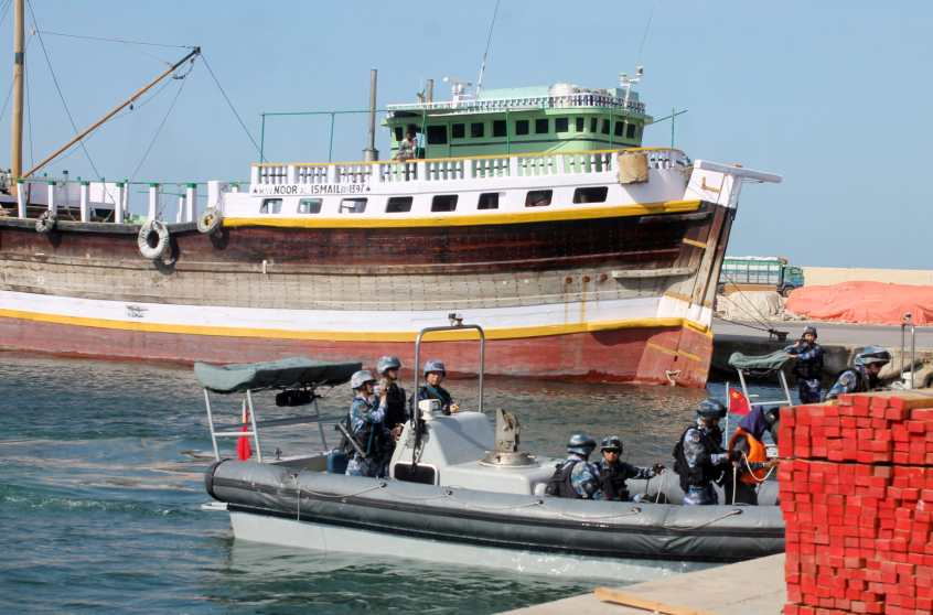 Chinese navy officers dock on the shores of the Gulf of Aden to hand over three suspected pirates involved in the attempted hijacking in April of the OS35, a Tuvalu-flagged cargo ship, to Somali authorities in the city of Bosasso, northern Somalia's semi-autonomous region of Puntland, May 5, 2017. REUTERS/Abdiqani Hassan