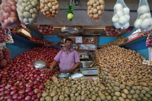 FILE PHOTO: A vendor waits for customers at his vegetable stall. February 13, 2017. Credit: Reuters/Shailesh Andrade