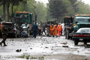 Afghan police and municipal workers clear debris from the site of a suicide bomb attack in Kabul, Afghanistan May 3, 2017. Credit: Reuters/Omar Sobhani