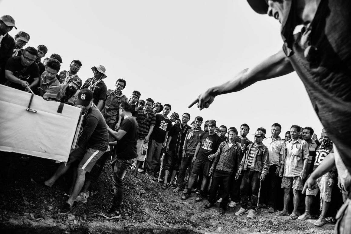 Volunteers from Churachandpur seen lowering a coffin into a common grave which volunteers and people from around the town dug the same day. Credit: Vivek Singh
