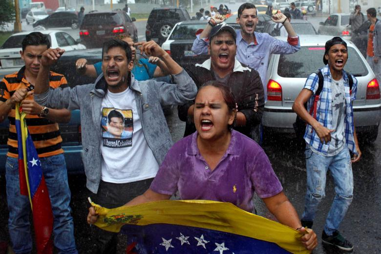 Opposition supporters shout slogans during a protest against Venezuelan President Nicolas Maduro's government in San Cristobal, Venezuela. Credit: Reuters/Carlos Eduardo Ramirez
