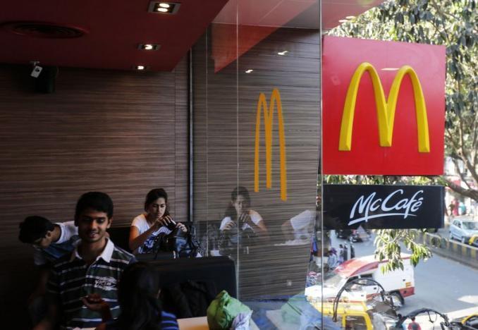 Visitors are seen at a McDonald's restaurant. Credit: Reuters/Shailesh Andrade