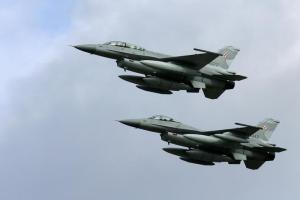 Two of the first four Polish Air Force F-16 fighter jets . Credit: Reuters