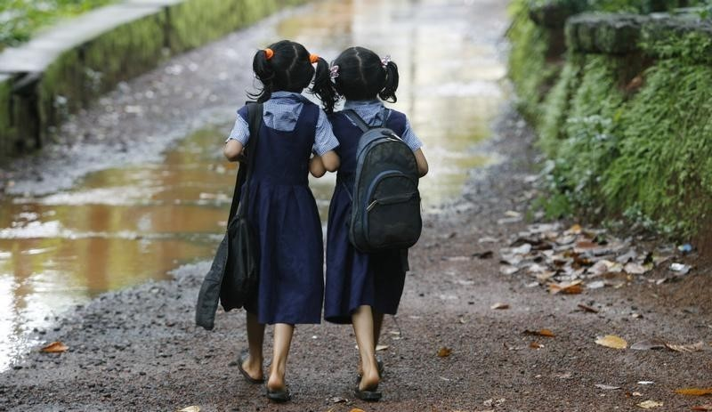 Seven year old twins walk to their school in Kerala. Credit: Reuters/Arko Datta/Files