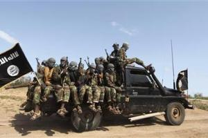 Members of al Shabaab, al Qaeda-linked insurgents, ride in a pick-up truck after distributing relief to famine-stricken internally displaced people at Ala Yaasir camp, outside Somalia's capital Mogadishu, September 3, 2011. Credit: Reuters