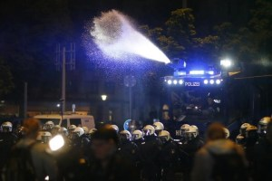 Police uses a water cannon during a protest at Schanzenviertel ahead the G20 summit in Hamburg, Germany, July 4, 2017. REUTERS/Hannibal Hanschke