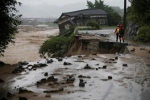Rescue workers walk at an area hit by heavy rain at Haki district in Asakura, Fukuoka Prefecture, Japan, July 7, 2017. Credit: Reuters/Issei Kato