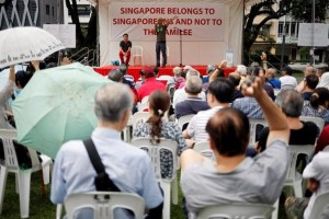 "Organiser Gilber Goh speaks to attendees at Hong Lim park during a protest to call for the ""independent investigation into the allegations of abuse of power made by siblings Lee Weiling and Lee Hsien Yang against their brother Prime Minister Lee Hsien Loong"" in Singapore, July 15, 2017. Credit: Reuters/Edgar Su"