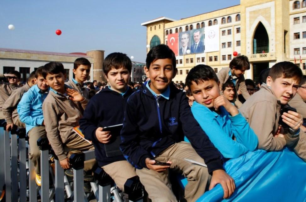 Students of Tevfik Ileri Imam Hatip School wait for the arrival of President Tayyip Erdogan for an opening ceremony in Ankara, Turkey November 18, 2014. Credit: Reuters/Umit Bektas