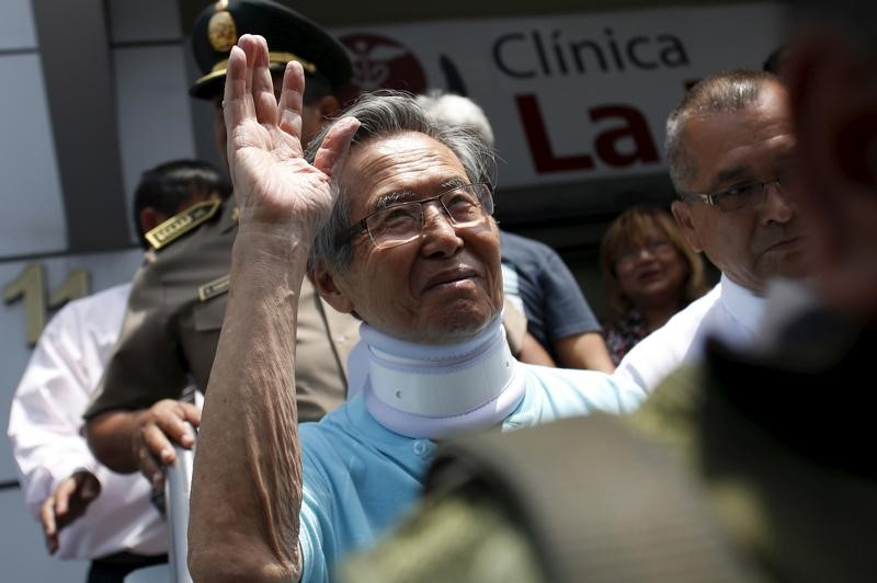 Peru's former President Alberto Fujimori leaves the clinic where he was transferred from his prison cell to undergo neurological tests after feeling dizzy and briefly losing the strength in his legs, his doctor said, in Lima, March 31, 2016. Credit: Reuters/Janine Costa