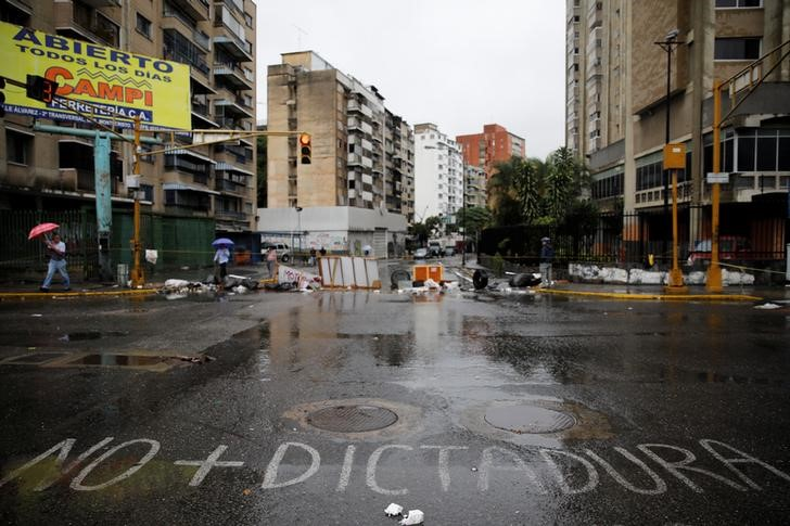 A sign reading 'No more dictatorship' is seen on a blocked street during a rally against Venezuelan President Nicolas Maduro's government in Caracas, Venezuela, July 19, 2017. Credit: Reuters/Carlos Garcia Rawlins