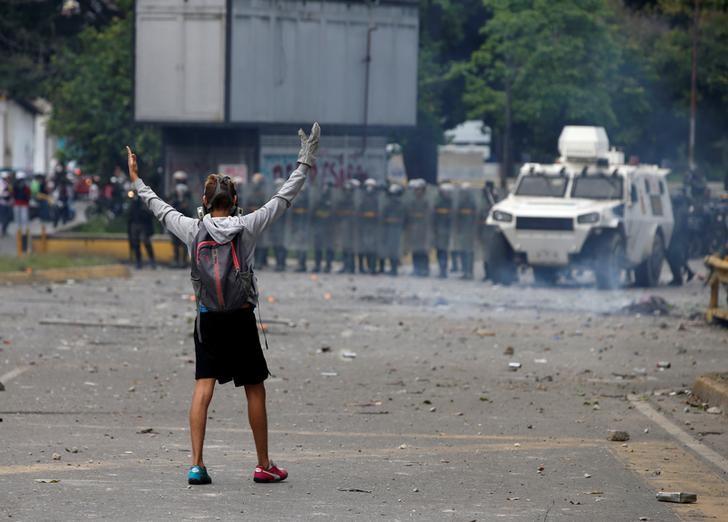 Venezuelan's opposition calls new strike, violence flares