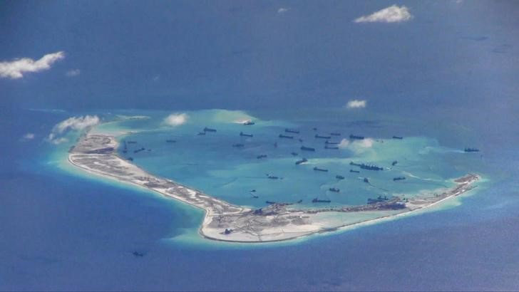 Chinese dredging vessels are purportedly seen in the waters around Mischief Reef in the disputed Spratly Islands in the South China Sea in this still image from video taken by a P-8A Poseidon surveillance aircraft provided by the United States Navy May 21, 2015. Credit: Reuters/US Navy