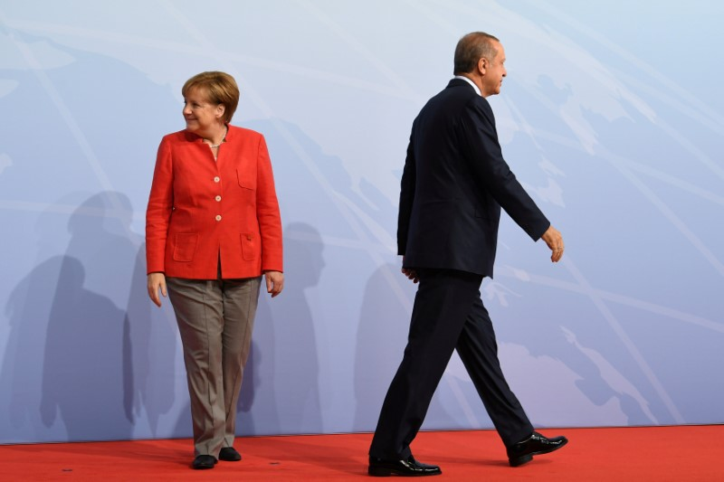 German Chancellor Angela Merkel greets Turkey's President Recep Tayyip Erdogan at the beginning of the G20 summit in Hamburg, Germany, July 7, 2017. Credit: Reuters/Bernd Von Jutrczenka/File Photo