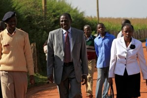 Kenya's deputy president William Ruto and his wife Rachael are escorted as they walk to their home in Sugoi village near Eldoret, Kenya, in this photo taken August 4, 2010. Credit: Reuters/Thomas Mukoya