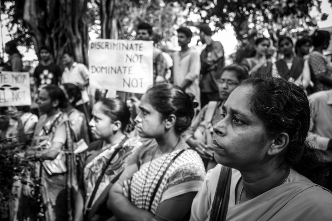 Protestors watch a performance. Credit: Prthvir Solanki