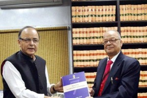 Finance Minister Arun Jaitley receiving the report of Seventh Pay Commission from its Chairman Justice A K Mathur in New Delhi on Thursday. (PTI)