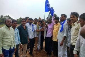 A blue flag is planted on the land allotted to Dalits in Lavara village. Credit: Damayantee Dhar