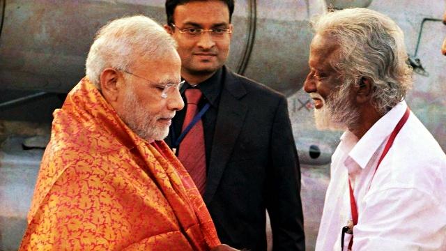 Prime Minister Narendra Modi with BJP state president Kummanam Rajasekharan. Credit: PTI