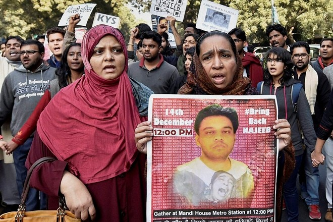 Najeeb Ahmed's family at a protest demanding an expedited investigation. Credit: PTI/Files