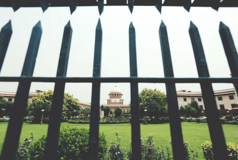 Supreme Court is pictured through a gate in New Delhi, India May 26, 2016. Credit: Reuters/Anindito Mukherjee