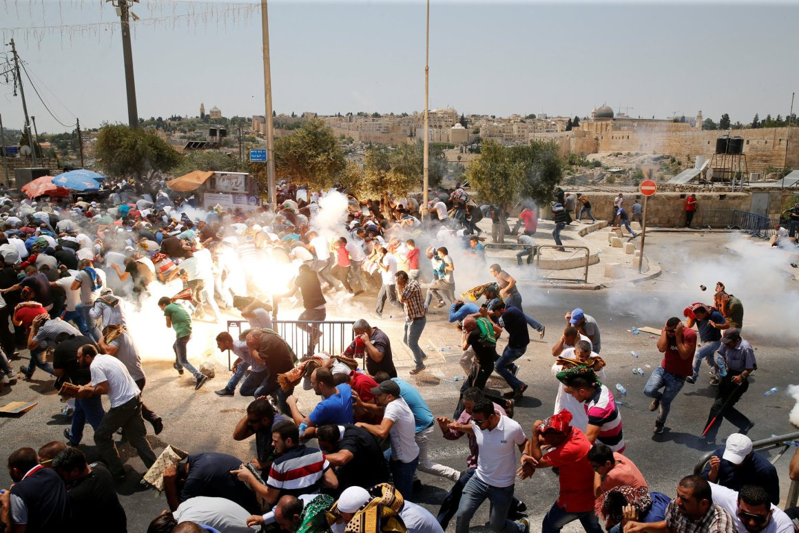 Israeli soldiers fired tear gas at Palestinians to disperse them after Friday Prayer on a street outside Jerusalem's Old City. Credit: Ammar Awad/ Reuters