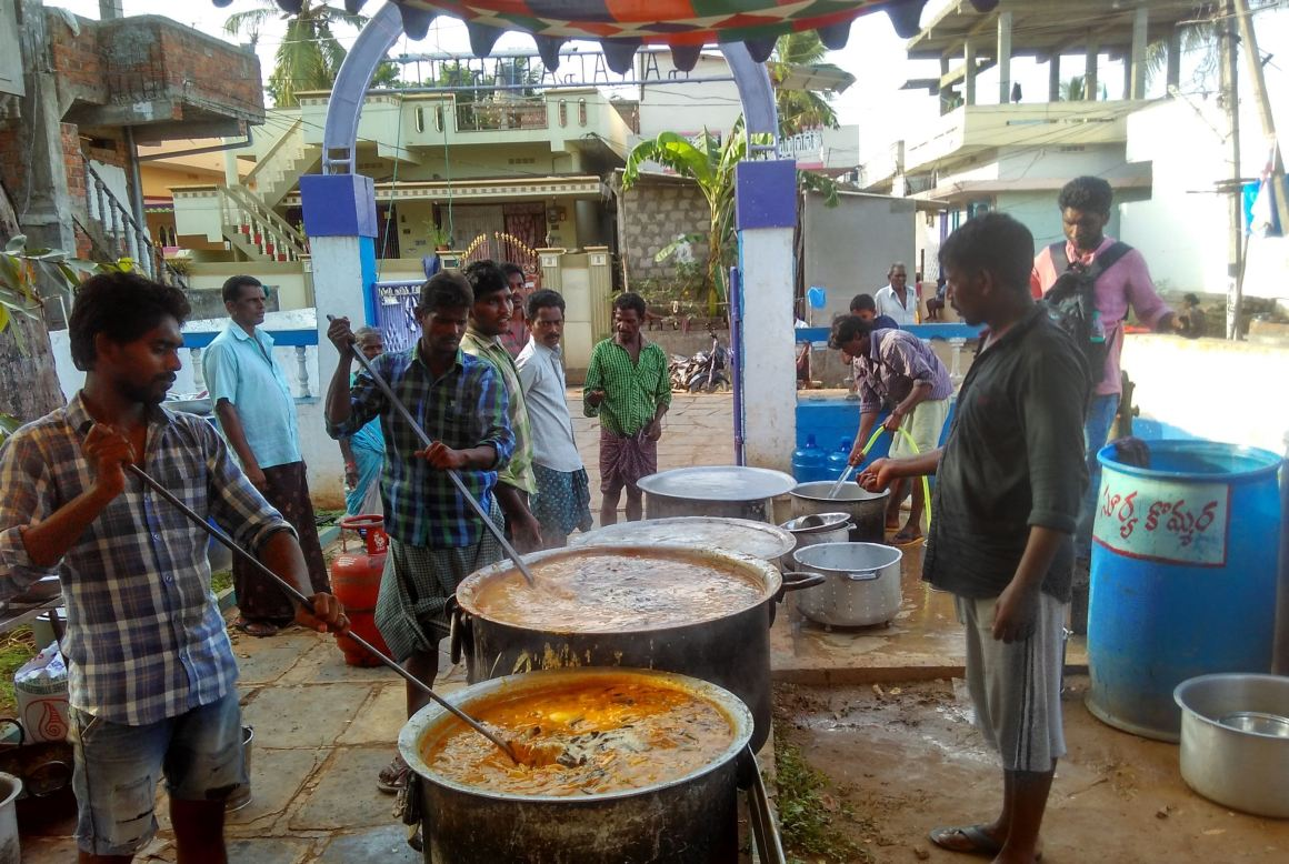 Community cooking in process near Lutheran Church in Ambedkar Colony. All the 1200 Dalits have been dining here, ever since the social boycott started, since they don't have money to cook. Credit: Rahul Maganti