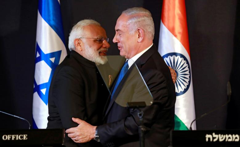 Indian Prime Minister Narendra Modi hugs with Israeli Prime Minister Benjamin Netanyahu as they deliver joint statements during an exchange of co-operation agreements ceremony in Jerusalem July 5, 2017. Credit: Reuters/Amir Cohen