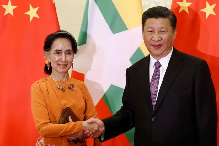 FILE PHOTO: Myanmar state counsellor Aung San Suu Kyi shakes hands with Chinese President Xi Jinping as they meet at the Great Hall of the People in Beijing, China, May 16, 2017. Credit: Reuters/Damir Sagolj/Files