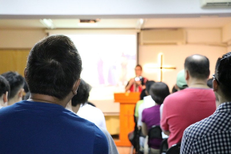 """Please do not reveal any identities in your photographs. If need be, please ask their permission"", Pastor Huang Guoyao cautioned this reporter minutes before the morning service commenced at the Tong-Kwang Light House Presbyterian Church. Situated in the center of a textile market in Zhongshan district, the church is not well known to most of the local shopkeepers in the neighbourhood. Credit: Makepeace Sitlhou"