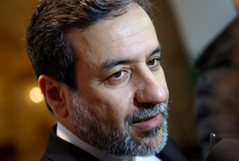 Iran's top nuclear negotiator Abbas Araqchi talks to journalists after meeting senior officials from the United States, Russia, China, Britain, Germany and France in a hotel in Vienna, Austria, October 19, 2015. Credit: Reuters/Heinz-Peter Bader/File Photo