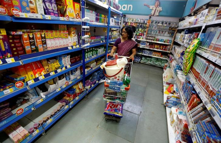 A woman pushes a shopping trolley at a food superstore in Ahmedabad, October 13, 2016. Credit: Reuters/Amit Dave/Files