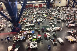 Evacuees take shelter from hurricane Harvey in the George R. Brown Convention Center in Houston, Texas, U.S. in this handout photo, 27th August 2017. Five former US Presidents - Barack Obama, George W Bush, Bill Clinton, George HW Bush and Jimmy Carter have come together to help raise funds for victims. Credit: Reuters