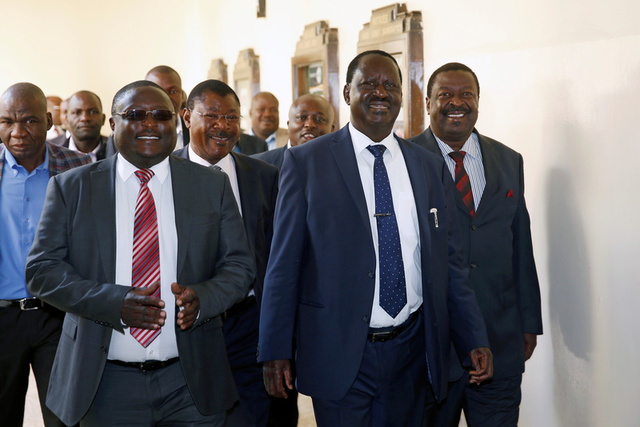 Kenyan opposition leader Raila Odinga (2R) from the National Super Alliance (NASA) coalition arrives for a hearing of a petition challenging the election result at the Supreme Court in Nairobi, Kenya August 28, 2017. Credit:Reuters