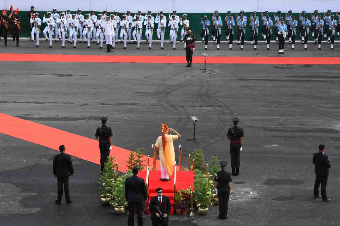 Prime Minister Narendra Modi inspect a guard of honour before addressing the nation from the ramparts of Red Fort during the Independence Day function in New Delhi on Tuesday. Credit: PTI/Shirish Shete