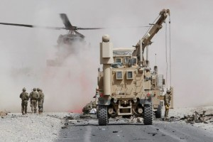 US troops assess the damage to an armoured vehicle of NATO-led military coalition after a suicide attack in Kandahar province, Afghanistan August 2, 2017.Credit:Reuters