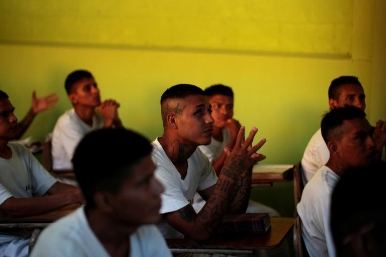 """Retired members of the 18th Street Gang participate in a class during the opening of the """"Yo Cambio"""" (I Change) program at the San Francisco Gotera jail in San Francisco Gotera, El Salvador. Credit: Reuters/Jose Cabezas"""