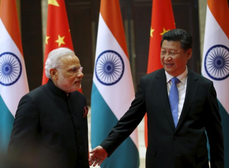 File photo of Chinese President Xi Jinping with Indian Prime Minister Narendra Modi. Credit:Reuters/Kim Kyung-Hoon