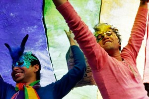 Participants dance under a a rainbow flag as they attend the sixth Delhi Queer Pride parade, an event promoting gay, lesbian, bisexual and transgender rights, in New Delhi November 24, 2013. Credit: Reuters