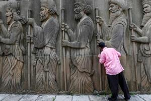 A Parsi man touches the walls of a Parsi fire temple in Mumbai. Credit: PTI
