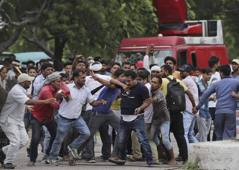 Minutes before the national and local media personnel faced violent attacks in Panchkula. Credit: PTI